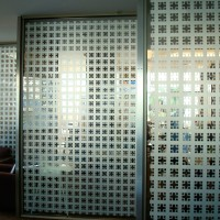 Decorative Etch Film -  Patterned dye cut film applied to interior glass panels