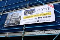 Vinyl banner -  Vinyl banner with the works - UV Laminated, Hemmed, Eyelets, Ropes we
